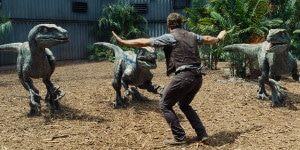 "Owen (CHRIS PRATT) attempts to keep the raptors at bay in ""Jurassic World"".  Notice the number of toes..."
